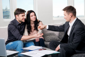 Real estate agent gives the couple the keys to a new apartment